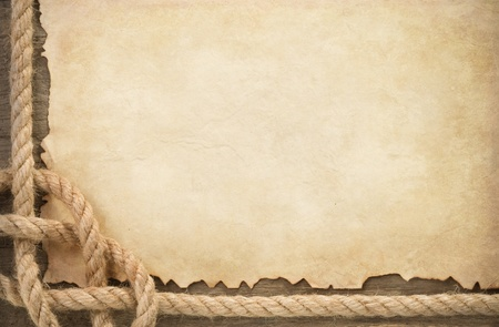 fixed line: ship ropes at parchment old paper background texture