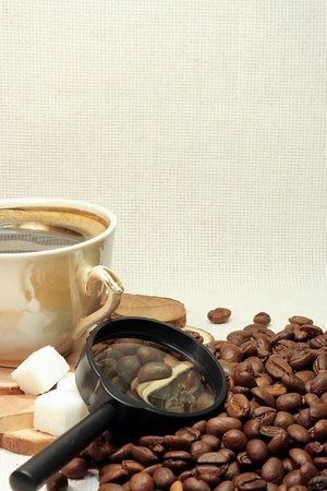 roasted coffee beans and cup photo