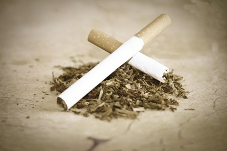 robustness: cigarette and tobacco on background Stock Photo