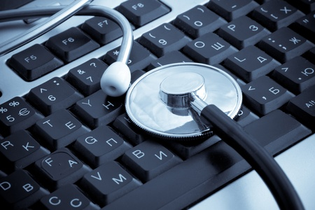 isolated stethoscope at keyboard background photo