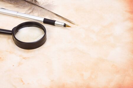 magnifying glass and pen at background Stock Photo - 12624958