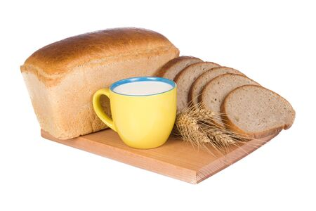 closeup of bread and cup with milk photo