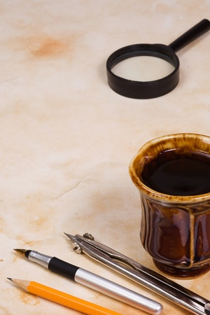 pencil, pen and cup of tea Stock Photo - 12624940