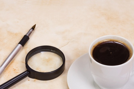 magnifying glass and coffee at texture photo