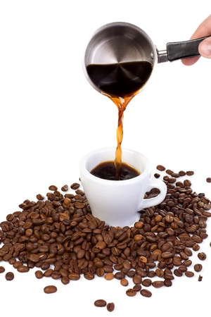 seed pots: coffee beans and outpouring coffee Stock Photo