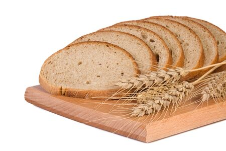 isolated wheat ear and bread photo