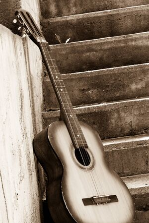 guitar: sepia image of guitar near steps