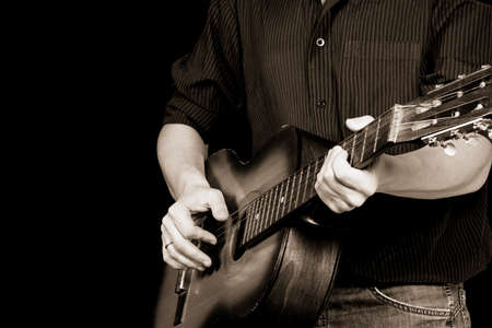 guitar and man in sepia photo