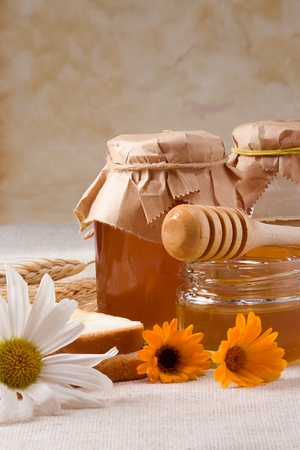 bagging: several flowers and honey on bagging
