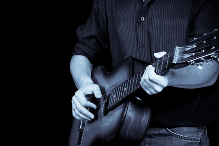 guitar and man in blue tint photo