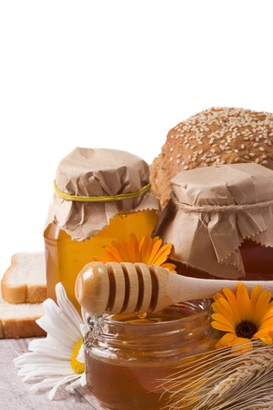 isolated glass of honey and bread photo