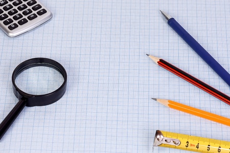 school accessory and magnifier at paper photo