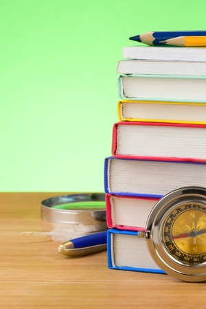 back to school supplies on green background photo