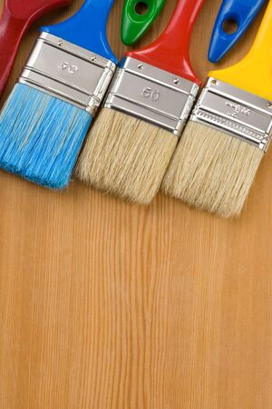 colorful paintbrush on wood background texture Stock Photo - 13005551