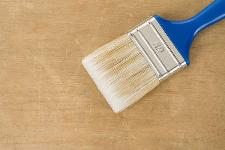 colorful paintbrush on wood background texture Stock Photo - 13005519