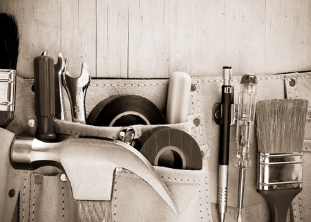 tools in construction belt on wooden background texture Stock Photo - 13005513