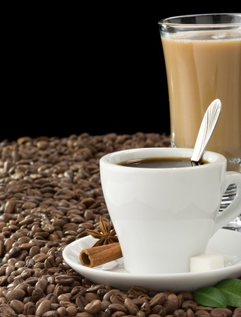 cup of coffee and beans isolated on black background photo