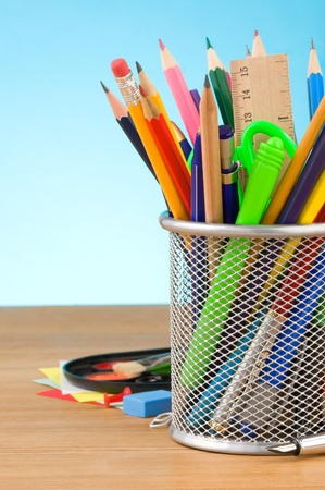 back to school concept and office supplies on blue background photo