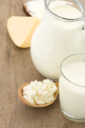 cheese and milk products on wood background photo