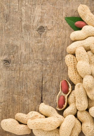pistachios nuts fruit on wood background texture