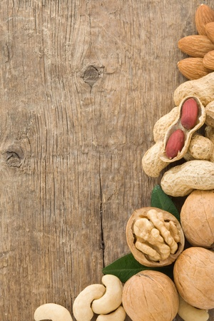 set of nuts fruit on wood background texture Stock Photo - 13005526