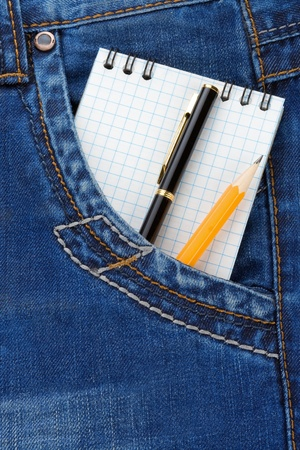 notebook and pencil on jeans packet background photo