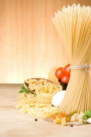pasta and food ingredient on wood background photo