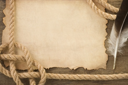 ropes and feather on old vintage ancient paper background texture photo