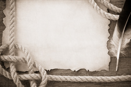 climbing cable: ropes and feather on old vintage ancient paper background texture