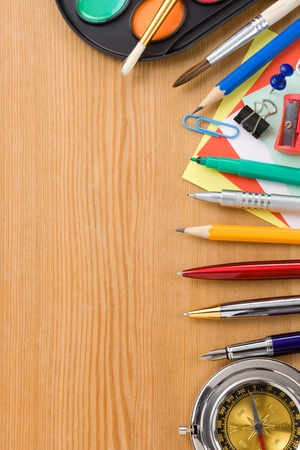 compas: back to school and supplies on wood background