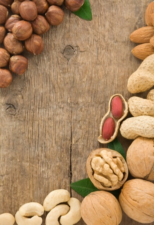 set of nuts fruit on wood background texture photo
