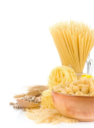 raw pasta and food ingredient isolated on white background photo