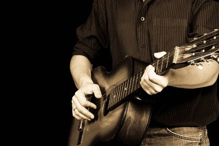 horizontal image of guitar and man
