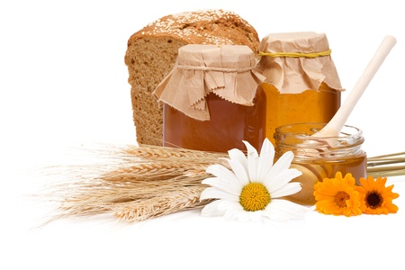 honey and bread on white photo