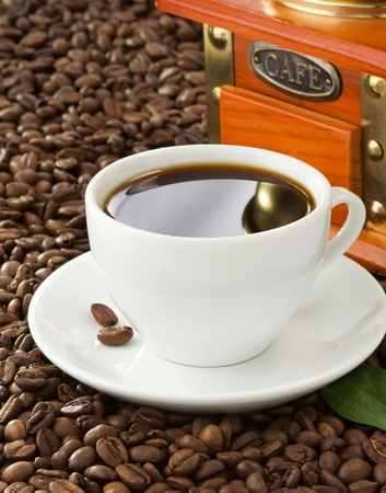 cup of coffee with beans on wood background texture Stock Photo - 13585858