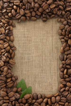 coffee beans on wood background texture photo