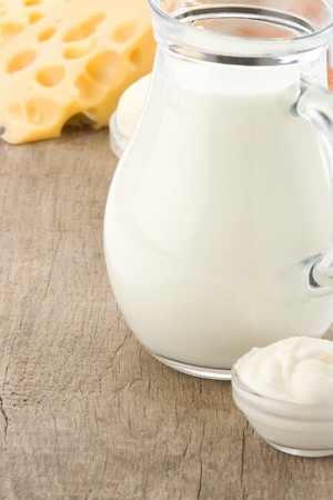 milk products: milk products and cheese on wooden background