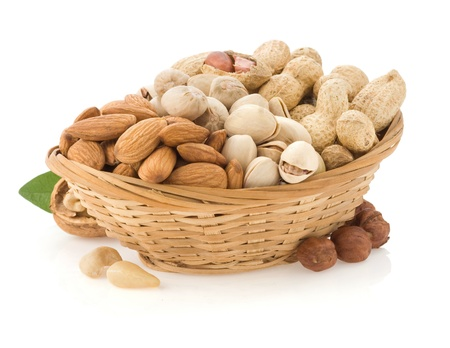 set of nuts in plate isolated on white background Stock Photo - 13585835