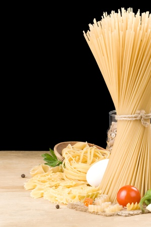 raw pasta and food ingredient isolated on black background photo