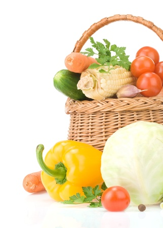 fresh vegetables and green leaves in basket isolated on white background Stock Photo - 13585833
