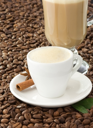 cup of coffee and beans as background photo