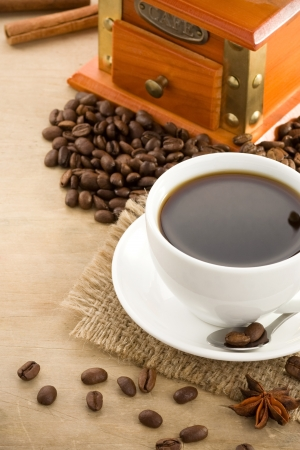 cup of coffee and beans on wood background Stock Photo - 13696647