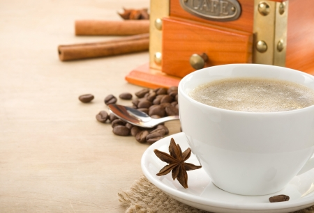 cup of coffee and beans on wood background photo