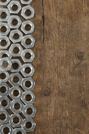 metal nuts tool on wood background photo