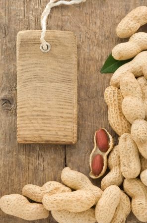 nuts peanuts fruit and tag price on wood background texture Stock Photo