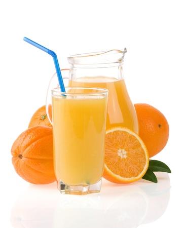 juice and oranges isolated on white background photo