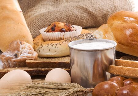 bread and bakery products on sack and pot with flour photo