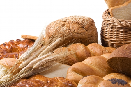 bread, spike, flour and basket isolated on sacking photo