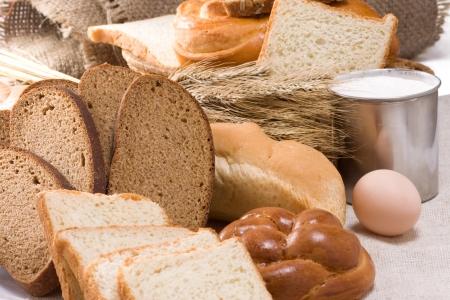 bakery products and basket on sacking photo