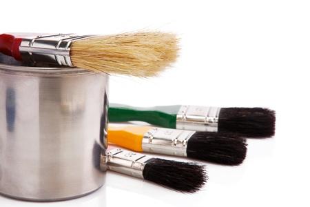 paint buckets and paintbrush isolated on white background photo